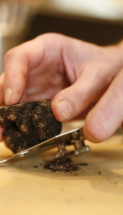 Black truffle being shaved